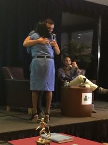gary hugs woman